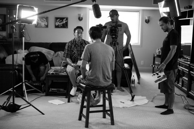 Filmmaker Tadashi Nakamura working on the documentary, Jake Shimabukuro: Life of Four Strings. Photo by Aaron Yoshino.
