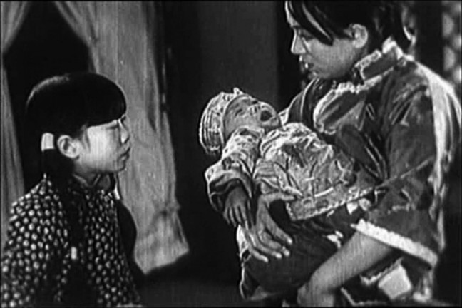 Actor Wang Renmei (with infant) in The Song of the Fishermen, playing at the SF Silent Film Festival on May 30.