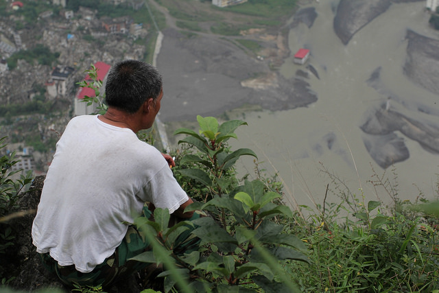 Li Mingshan, Brother Peng's father-in-law, looking down the old city on the mountain top. Photo credit: Shaoguang Sun.