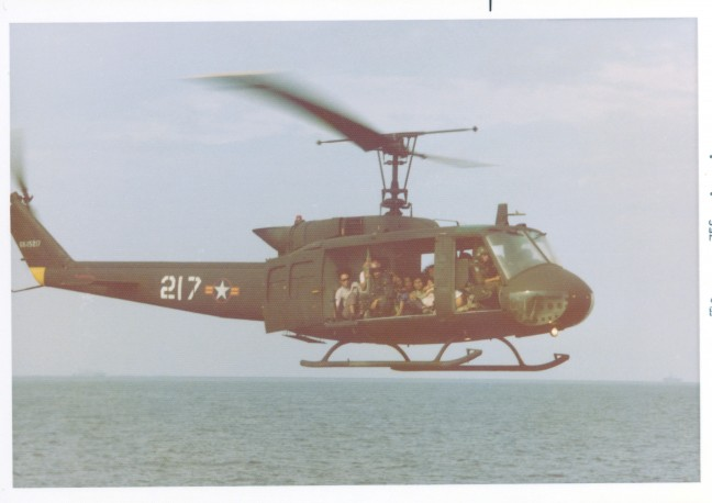 Refugees are flown in a helicopter, c. 1975. Image courtesy of Hugh Doyle.