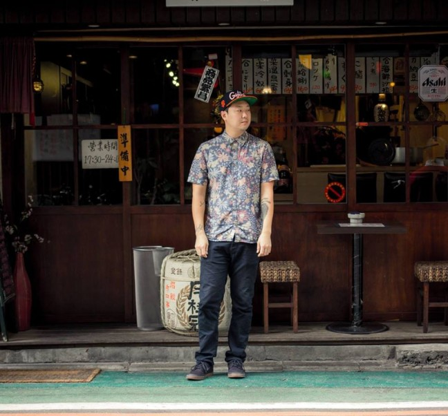 Chef and Korean adoptee Eric Ehler hangs out in front of a Sushi-Ya in Taipei. Photo credit: Pete Lee.