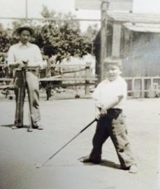 Jack Matsuoka with a golf club.