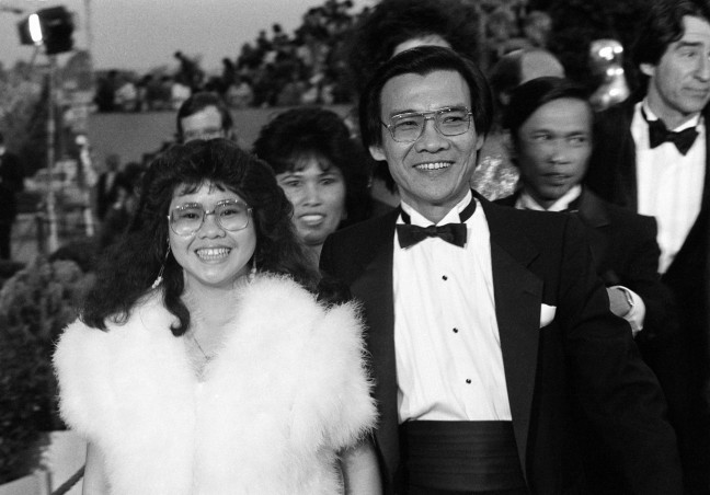 """Dr. Haing S. Ngor, right, accompanied by his niece Sophia Ngor, arrives at the 57th Annual Academy Awards® in Los Angeles, Calif., March 25, 1985. Ngor won the Best Supporting Actor Oscar® for his portrayal of a Cambodian refugee in the film """"The Killing Fields."""" (AP Photo by Mark Elias)."""