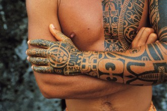 A man with elaborate tattoos in Huahine, Leeward Islands, French Polynesia. © Michel Renaudeau/age footstock. Photo courtesy of the Oakland Museum of California.