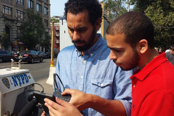 Hany Massoud (Production Mentor) reviewing footage with Ahmed on location in NYC. Photo by Riyaz.