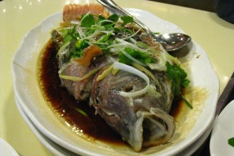 Whole steamed fish. Photo by RosieTulips via Flickr, Creative Commons.