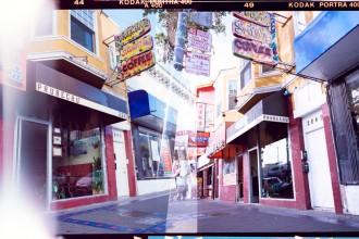 Exterior of Prubechu nestled between a Rent-A-Center and a Quickly's boba tea shop.
