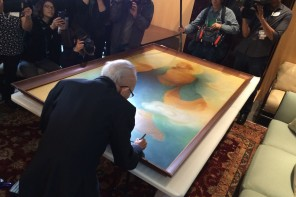 Tyrus Wong signs a painting from the 1930s at the Asian Art Museum on March 9, 2016. Photo by Ravi Chandra.