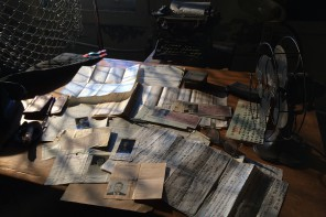 A tableau of immigration documents, coaching papers in Chinese and interrogation records set up for filming at Angel Island. Photo by THE CHINESE EXCLUSION ACT Producer Robin Espinola.