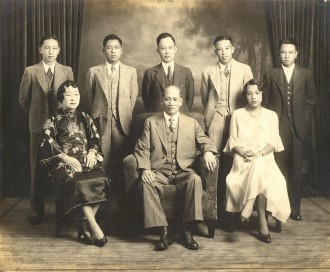The Lim Family, American born and educated, The Chinese Exclusion Act law made it difficult for the young generation to find employment,  forcing many families to seek opportunities back in China.  From L to R: sons Frank, Bill, Henry, Jimmy, George.  Seated: Alice Wong, Lim Ben, daughter Nancy. Courtesy the Lim Tong Family archives.