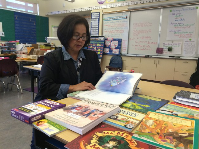 Bernadette A. Ison teaches second grade in the Filipino FLES program at Bessie Carmichael Elementary School in San Francisco. Here, she shows some of the Filipino curriculum.