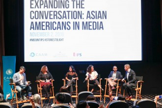 """Panelists at """"Expanding the Conversation: Asian Americans in Media"""" on Nov. 2 in Los Angeles. Left to right: Moderator Richard Lui, NBCUniversal executive Karen Horne, filmmaker Grace Lee, actress Sandra Oh, producer/writer Rashad Raisani, and NBCUniversal Executive Craig Robinson. Photo by Rich Polk/Getty Images."""