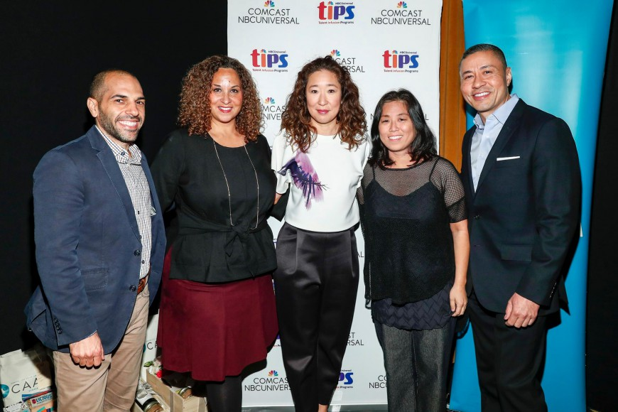 """Panelists at """"Expanding the Conversation: Asian Americans in Media"""" on Nov. 2 in Los Angeles. Left to right: producer/writer Rashad Raisani, NBCUniversal executive Karen Horne, actress Sandra Oh, filmmaker Grace Lee, and NBCUniversal Executive Craig Robinson. Photo by Rich Polk/Getty Images."""