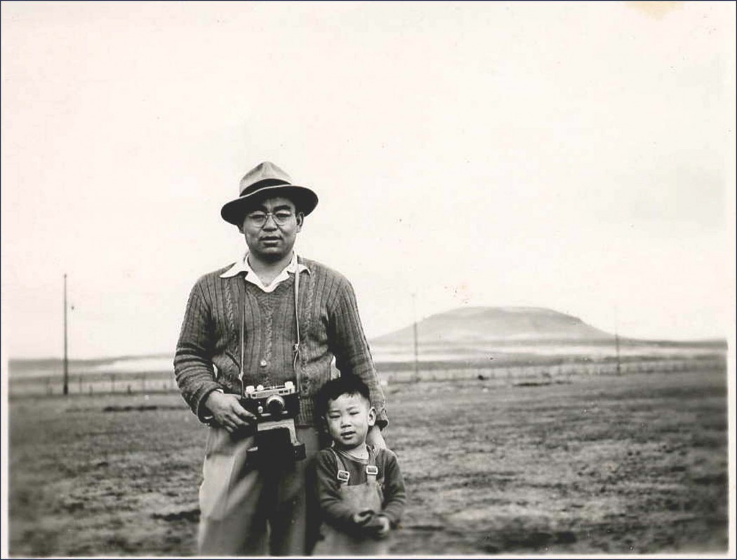 """Hiroshi Shimizu with his father Iwao Shimizu in Tule Lake Segregation Center, where he renounced his U.S citizenship, along with over 5,000 other Japanese Americans protesting their incarceration. March 18, 1946. Photo by Fusako Shimizu, courtesy of """"Resistance at Tule Lake,"""" directed by Konrad Aderer."""