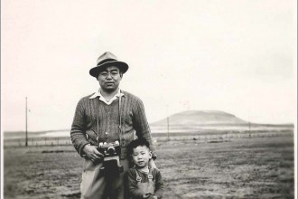"Hiroshi Shimizu with his father Iwao Shimizu in Tule Lake Segregation Center, where he renounced his U.S citizenship, along with over 5,000 other Japanese Americans protesting their incarceration. March 18, 1946. Photo by Fusako Shimizu, courtesy of ""Resistance at Tule Lake,"" directed by Konrad Aderer."