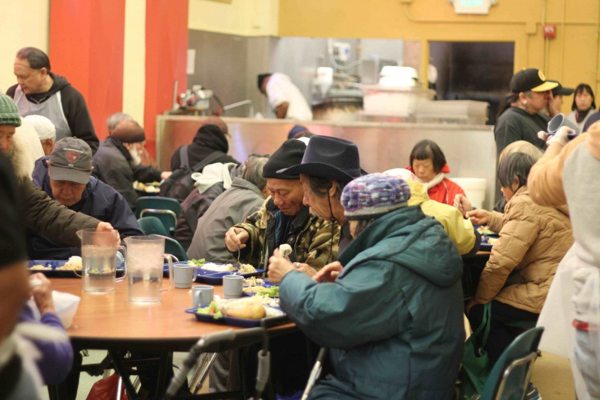 Community members gather for a holiday meal at Glide Memorial Church, served by Chefs Without Borders / Asian Chefs Association.