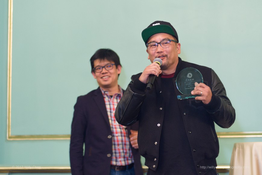 "Roy Choi accepts the ""Trailblazer"" award at CAAMFeast. Photo by Willy Chen."