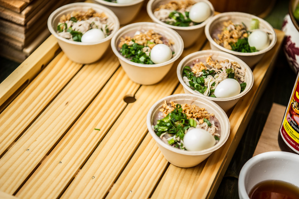 Heirloom Kalinga Unoy and brown rice Arroz Caldo served with chicken fat, chicken, scallion & green garlic confit, fried garlic chicharrones, quail egg, fish sauce and calamansi citrus from Attic, CAAMFeast 2016. Photo by Jason Jao.