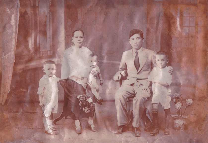 China c. 1929 -- A Lowe Family portrait taken with Samuel Lowe (Lowe Ding Chow), sons Chow Woo, Chow Kong and Chow Ying, and his wife, Ho Swee Yin.