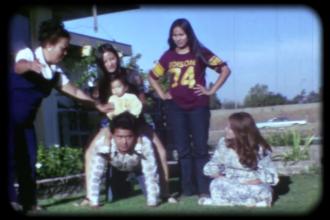 Film still of Bohulano family pyramid. Courtesy of Dawn Bohulano Mabalon, Memories to Light, Center for Asian American Media.