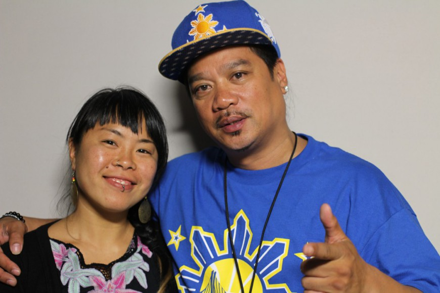 Geraldine Ah-Sue and Rudy Corpuz, Jr. chat in the StoryCorps booth.