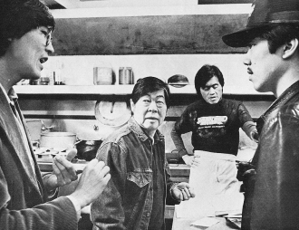 Wayne Wang discusses a scene with Wood Moy (Jo),Peter Wang (Henry) and Marc Hayashi (Steve) . Photo by Nancy Wong, 1981.