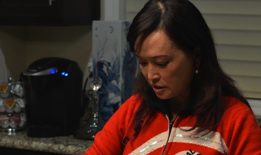 Theresa Lin cooks a meal in her Rancho Cucamonga home. Photo by Clarissa Wei.