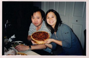 Wendy with her father, Tom Lieu, during a Thanksgiving holiday celebrating with a pecan pie. Photo courtesy of Wendy Lieu.