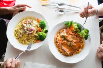 Two of the pasta dishes served as part of the CHAMPSS menu for seniors at Prince Cooking, a Hong Kong-style restaurant in San Francisco's Outer Sunset district. Photo by Andria Lo.