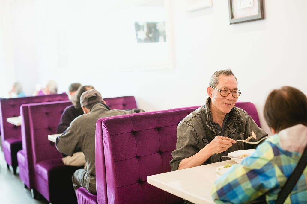 Outer Sunset resident David Lok eating lunch off the CHAMPSS Menu at Prince Cooking. Photo by Andria Lo.