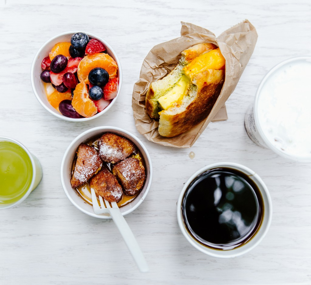Brekkie Egg in the Hole, French Toast Holes, Yogurt and Granola, Fresh Fruit, Coffee and Green Juice. Photo by Audrey Ma.