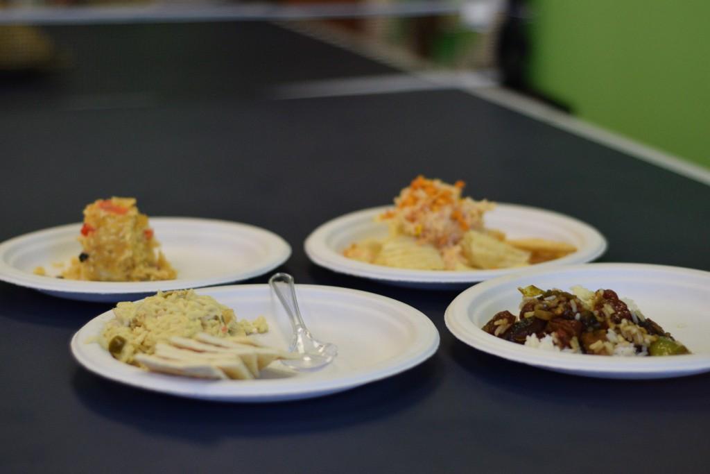 Clockwise from top left: Zheng's Fritos-ramen-casserole, Agakian's jalapeno-ramen-tuna on chips, Thao's Chinese sausage fried rice, Seuga's tuna-ramen on saltines. Photo by Kiwi Illafonte.